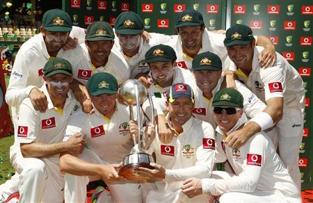 The Australian team pose with the Border-Gavaskar Trophy after winning the series 4-0 against India in Adelaide